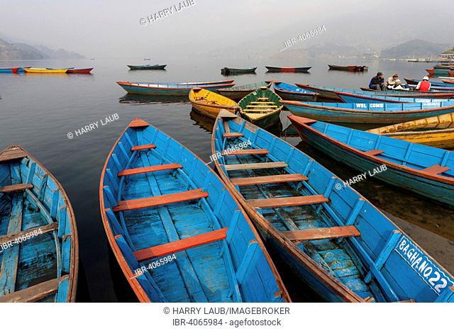 Colourful boats on Phewa Lake, Phewa Tal or Fewa Lake, Pokhara, Nepal