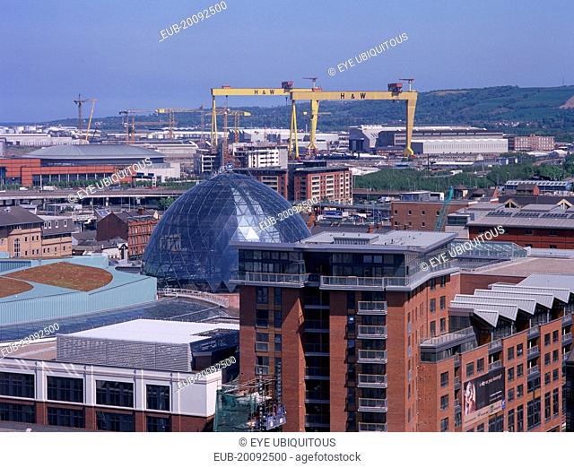 Cityscape with Victoria Square shopping centre dome and cranes seen from The Belfast Wheel at City Hall
