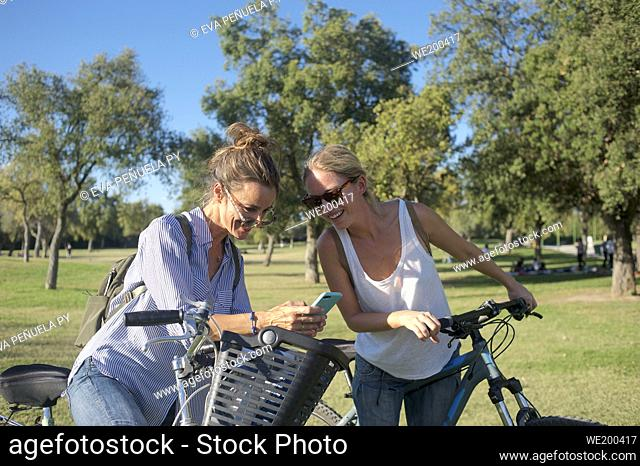 Group of friends enjoying an afternoon on bicycles in the park...