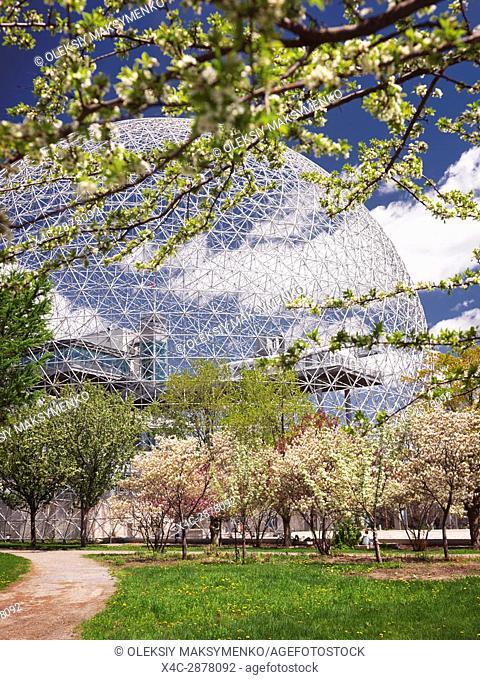 Montreal Biosphere and blossoming fruit trees springtime day scenery, Saint Helen's Island, Montreal, Quebec, Canada. Biosphère de Montréal, Ville de Montréal