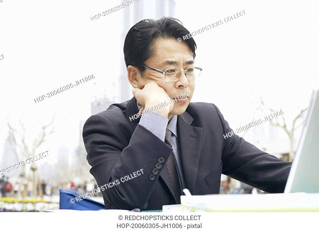 Close-up of a businessman using a laptop