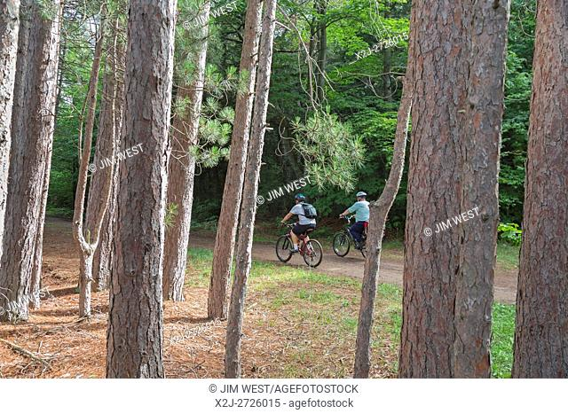 Munising, Michigan - Mountain bikers ride through a stand of red pine in Grand Island National Recreation Area. Grand Island is off the north shore of...