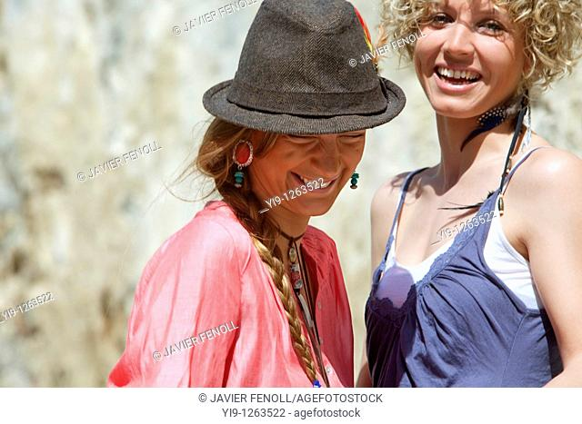 Two girl friends laughing
