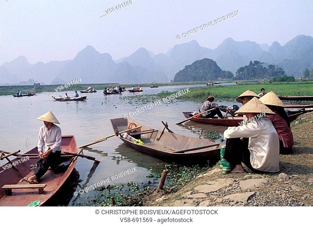 Pilgrim boats on the way to the perfume pagoda, chua huong, Hanoi region, Vietnam
