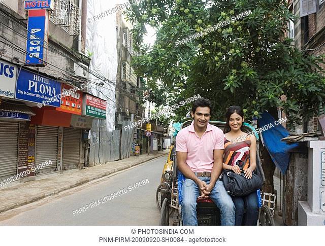 Couple sitting on a rickshaw, Kolkata, West Bengal, India