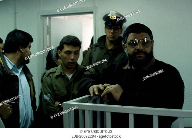 Dr Abdel Aziz al Rantissi standing in a cage, dock inside an Israeli courthouse. The co-founder and political leader of Hamas a Palestinian militant Islamist...