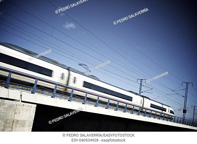 view of a high-speed train crossing a viaduct in Sagides, Soria, Castilla Leon, Spain. AVE Madrid Barcelona