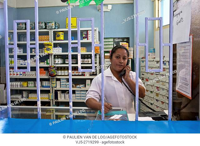 El Milagro, Guatemala, a pharmacist is on the phone taking an order