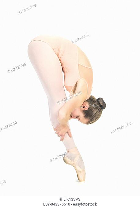 Young,smiling girl dancing the ballet. Studio shot of ballet on a white background. The isolated image
