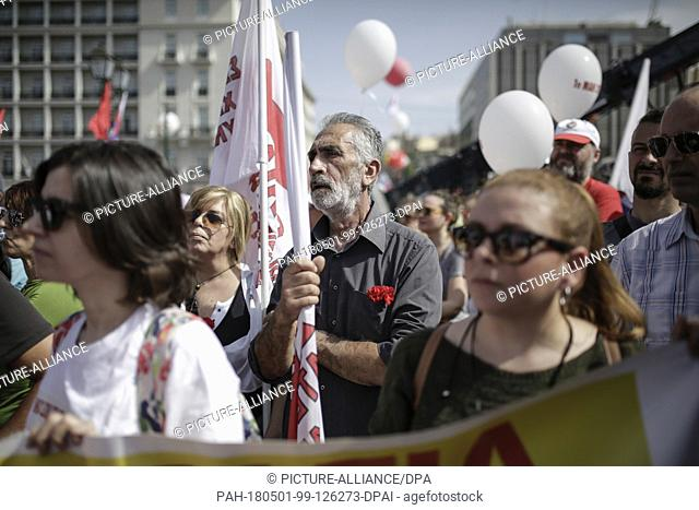 01 May 2018, Greece, Athens: Members of the pro-communist union PAME take part in a May Day rally outside the Greek Parliament