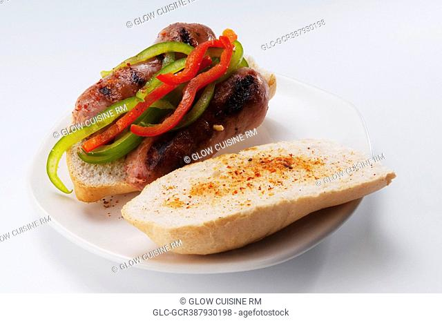Close-up of a sausage and peppers sandwich