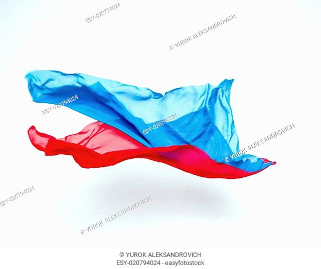 abstract pieces of blue and red fabric flying