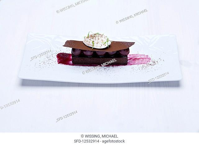 Gianduja cake with morello cherry compote and vanilla foam