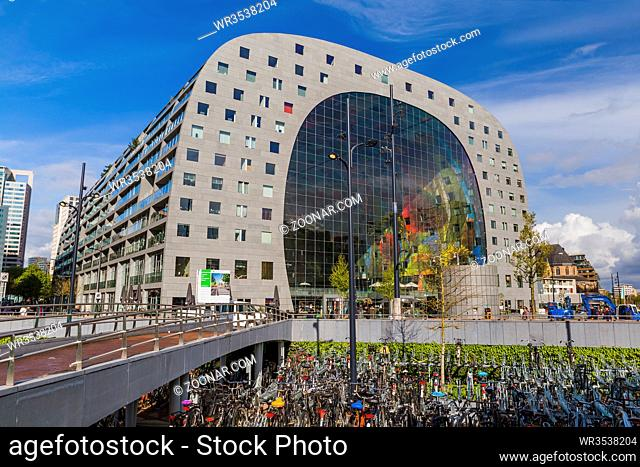 Rotterdam, Netherlands - April 27, 2017: Famous modern market Markthal and bicycle parking in Rotterdam