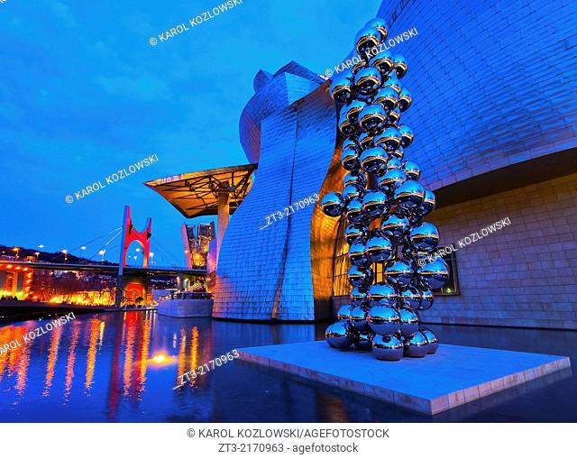 "Night view of the Sculpture """"The Big Tree"""" consisting of 80 stainless steel balls with reflections by Anish Kapoor in front of The Guggenheim Museum in Bilbao"