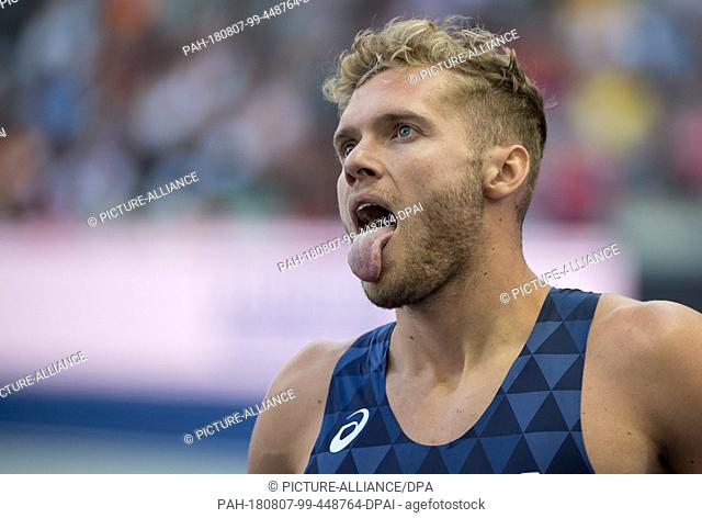 07.08.2018, Berlin: Track and Field, European Championships in the Olympic Stadium, Decathlon 100m, Men. Kevin Mayer from France sticks out his tongue at the...