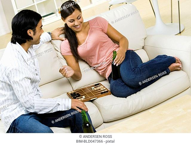 Multi-ethnic couple playing game