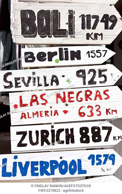 Wooden signpost with different international destinations on them, Menorca, Balearic Islands, Spain