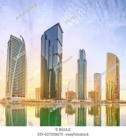 Panoramic view of Business bay and Lake Tower, reflection in a river, Dubai UAE