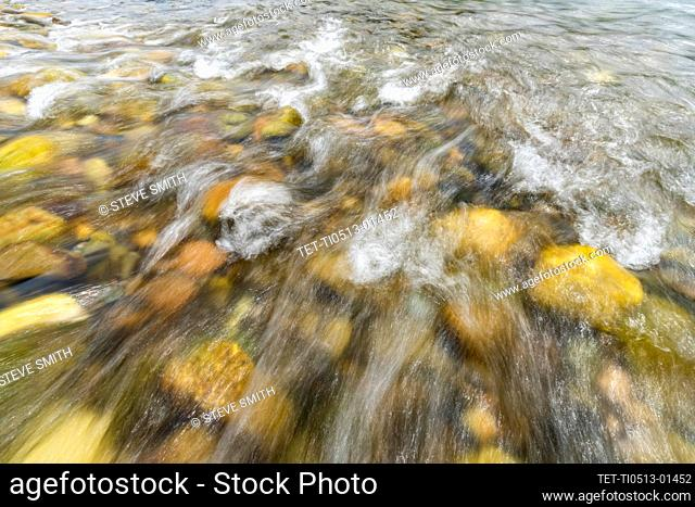 Blurred Big Wood River water and rocks