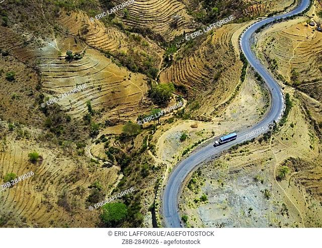 Aerial view of a truck passing in the Konso hills and terraces, Omo Valley, Konso, Ethiopia