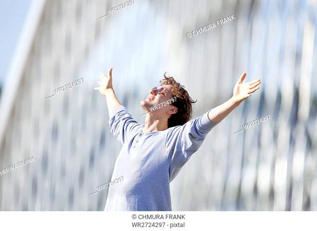 Excited Young Man Stretching out his Arm in Emotion