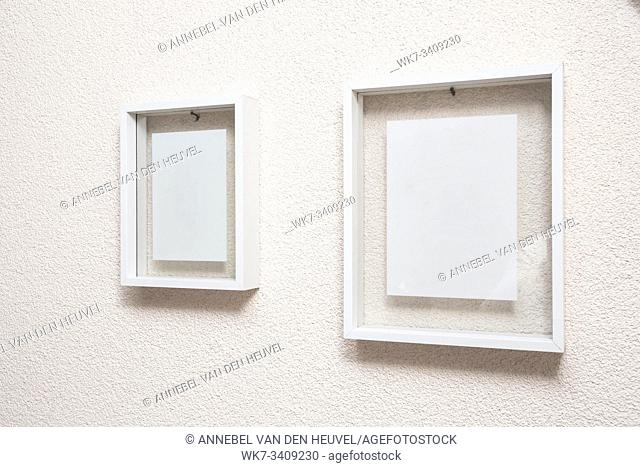 Two blank frame on white wall clean modern design texture