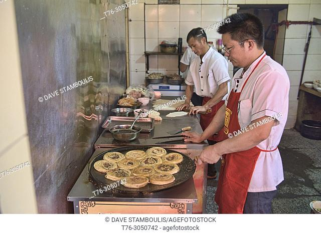 Guo kui fried meat pies, a specialty of Chengdu, Sichuan, China