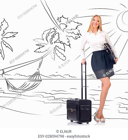 Businesswoman dreaming of beach vacation