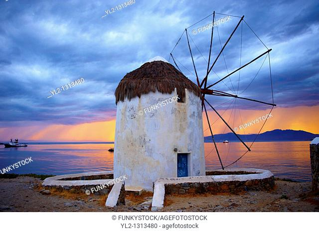 Sunset over the traditional Greek windmills of Mykonos Chora  Cyclades Islands, Greece