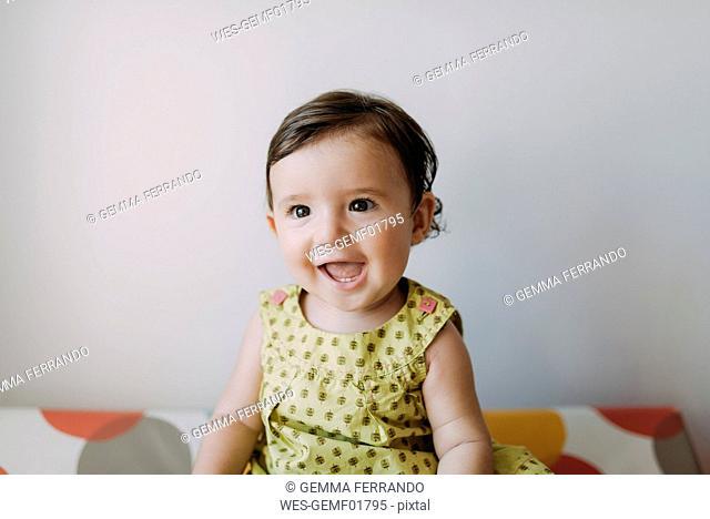 Portrait of happy baby girl wearing a dress