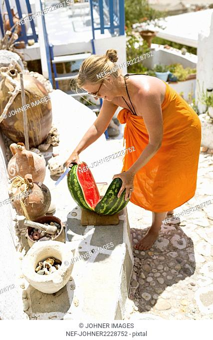 Woman cutting watermelon