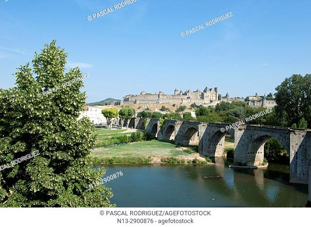 """World heritage of UNESCO, the Cite of Carcassonne and """"""""old bridge"""""""" with Aude river. Occitanie France"""