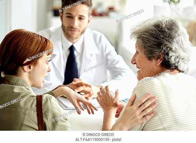 Mother and daughter talking in clinic