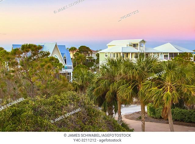 Sunrise over houses on St George Island in the panhandle or forgotten coast area of Florida in the United States