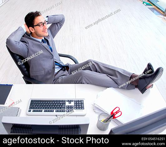 The young businessman working at his desk