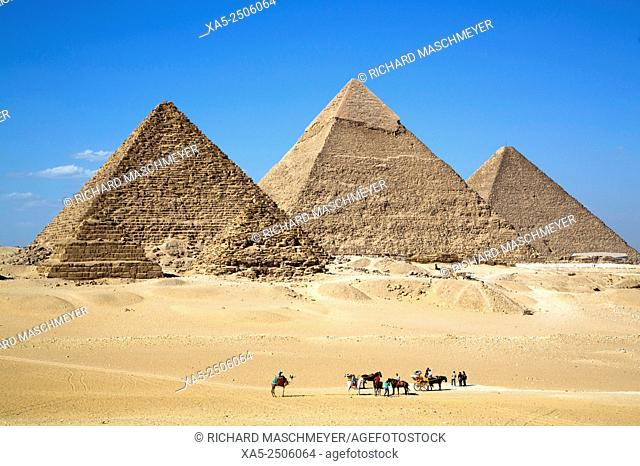 Tourists with Guides (foreground), The Giza Pyramids, Giza, Egypt