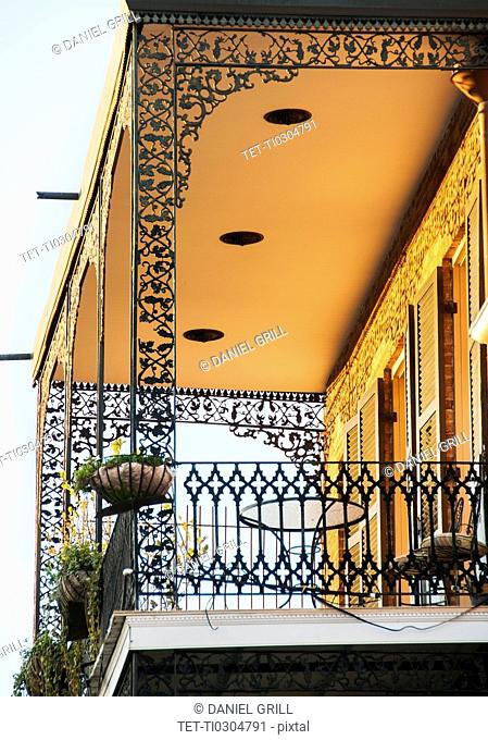 Ornate balcony with potted plants