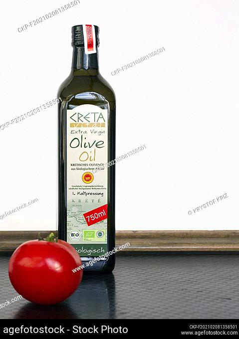 Extra virgin bio olive oil Creta and a tomato pictured as still-life in Bergheim, Germany on December 13, 2020. (CTK Photo/Krystof Kriz)
