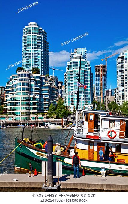 Historic steam powered vessel against the Vancouver waterfront at False Creek