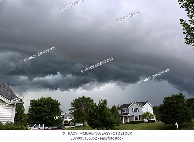 A storm front of clouds arching over a suburban neighborhood in Wisconsin