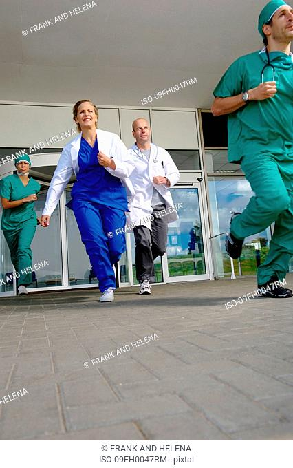 Medical team rushing out of door