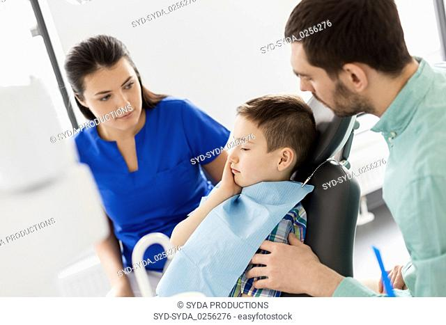 father and son visiting dentist at dental clinic