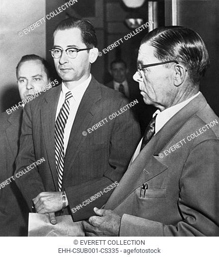 Dr. Albert Blumberg, an accused and admitted Communist, in handcuffs, Oct. 20, 1954. In 1956 he was convicted under a provision of the 1940 Smith Act