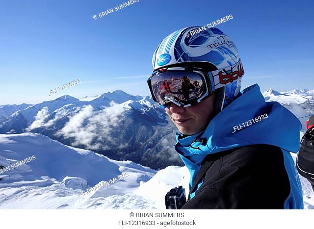 Skier at top of ski hill; Whistler, British Columbia, Canada