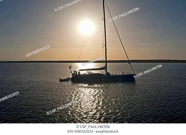 Large sailing yacht in sunset