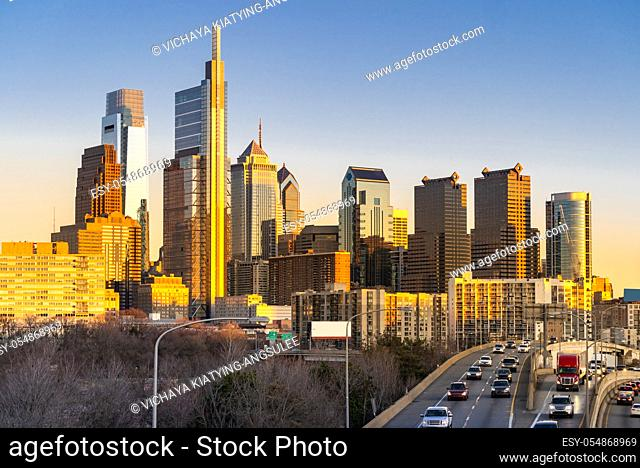 Cityscape of Philadelphia skyscraper Skylines building sunset with interstate highway urban road transportation in Philly city downtown of Philadelphia in PA...