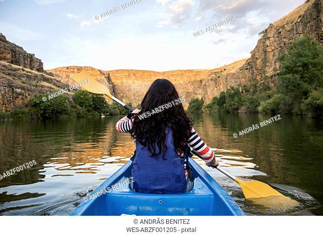 Spain, Segovia, Woman in a canoe in Las Hoces del Rio Duraton