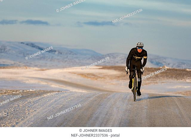 Man cycling at winter