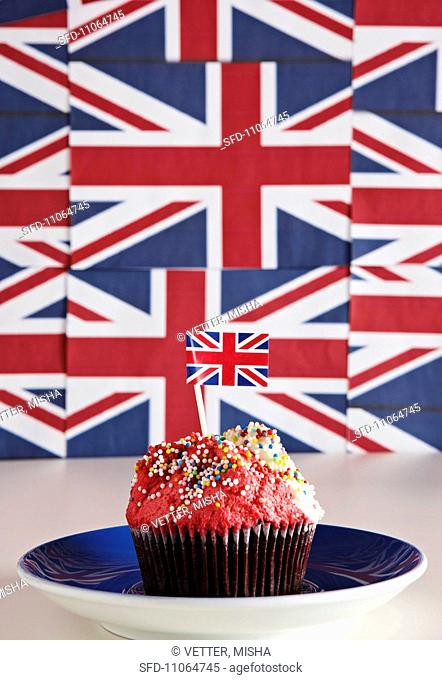 A cupcake topped with cream and a Union Jack